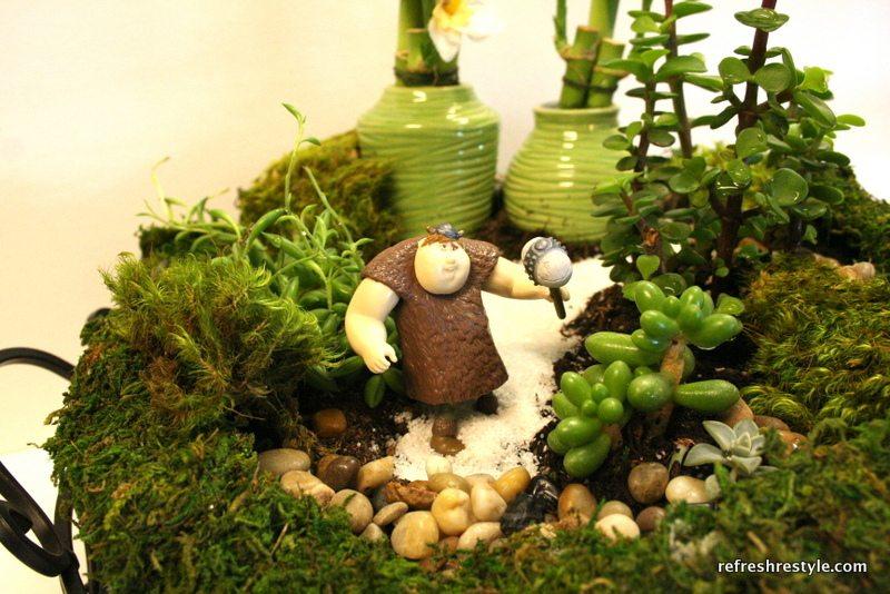Add fun mini characters to create a fun miniature garden.