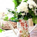fresh flowers in a watering can