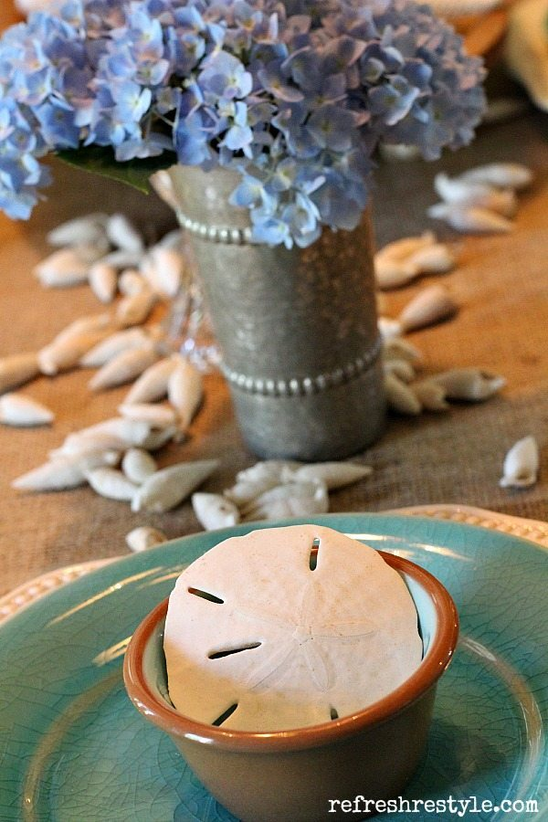 Coastal tablescape with sand dollars and aqua