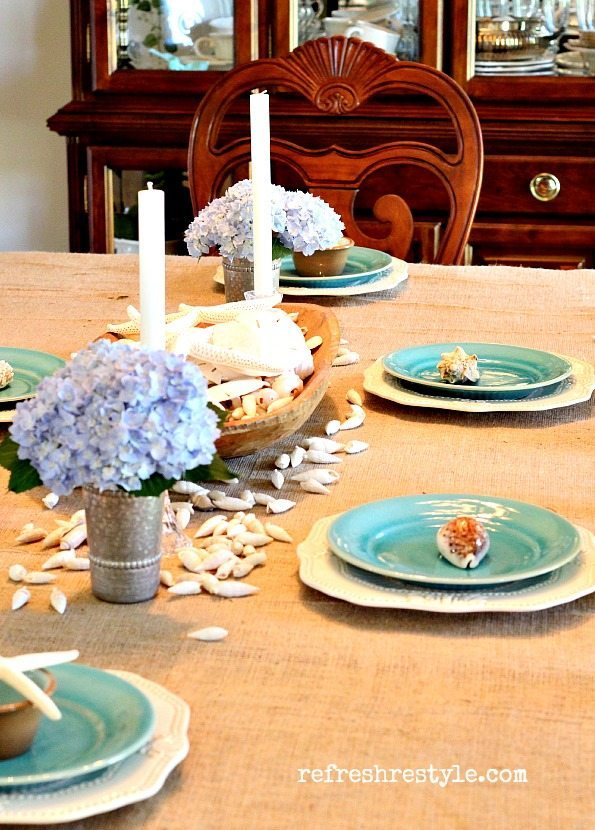 coastal tablescape with sea shells and hydrangeas