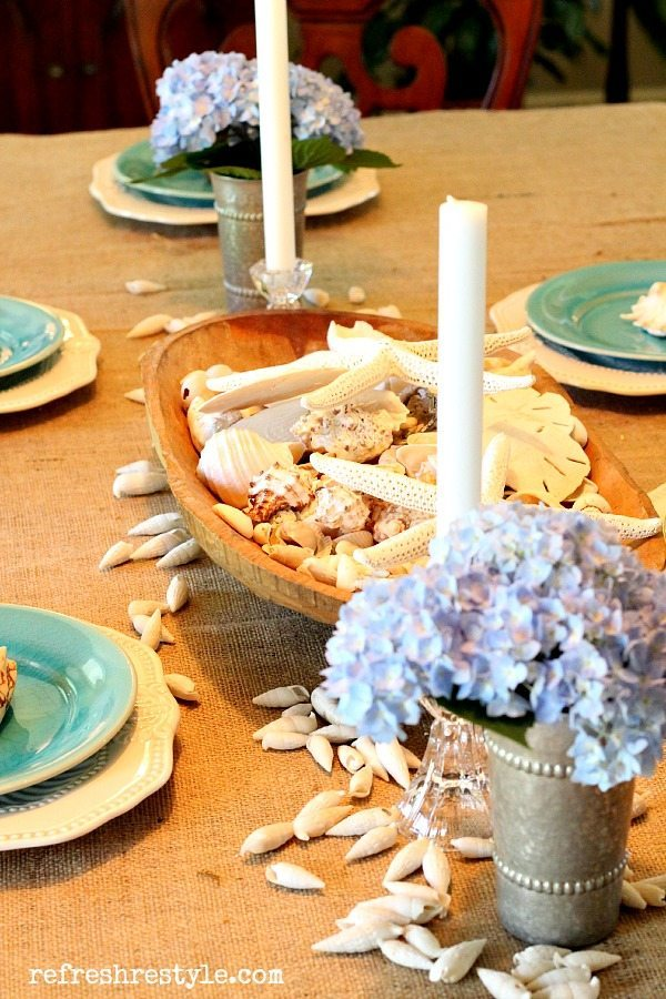 coastal tablescape with aqua, starfish, seashells and sand dollars
