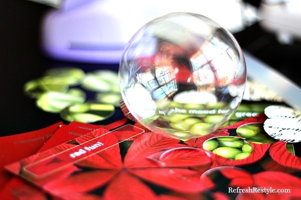 Handmade ornament with clear ball and paint chips
