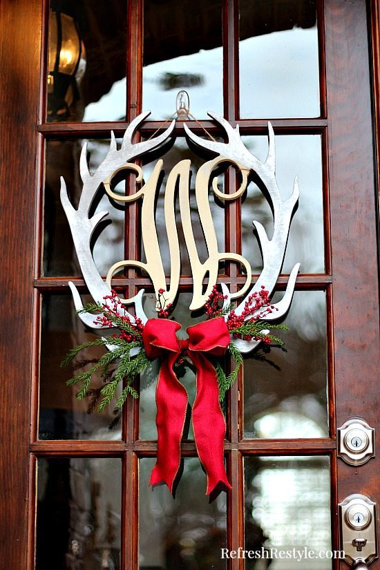 Christmas Door Wreath with berries and bow at refreshrestyle.com