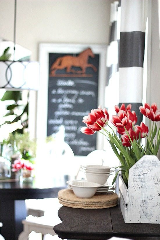 Spring tulips in frugal decor.