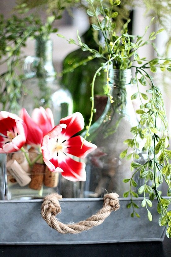 Fresh tulips and recycled wine bottles