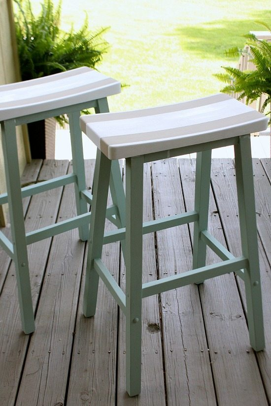 Saddle Seat bar stools painted with 3 colors to go with decor.