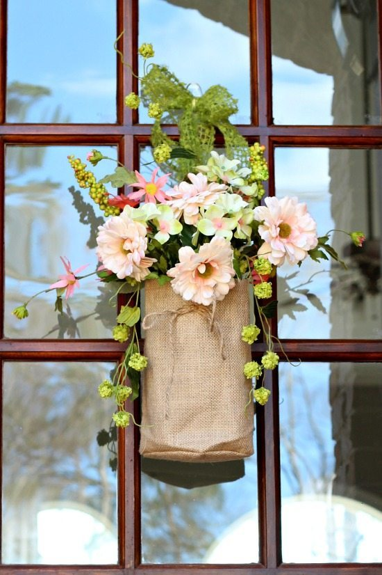 Corals, greens, pinks flowers in burlap bags