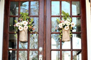 Double doors with pretty burlap bags filled with flowers