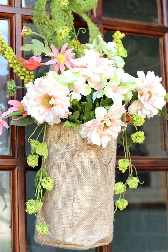 Spring flowers in burlap bags for the front door