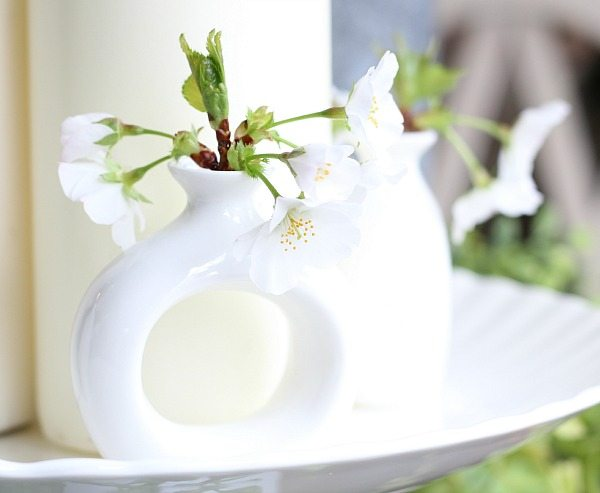 White flowers in napkin ring vases