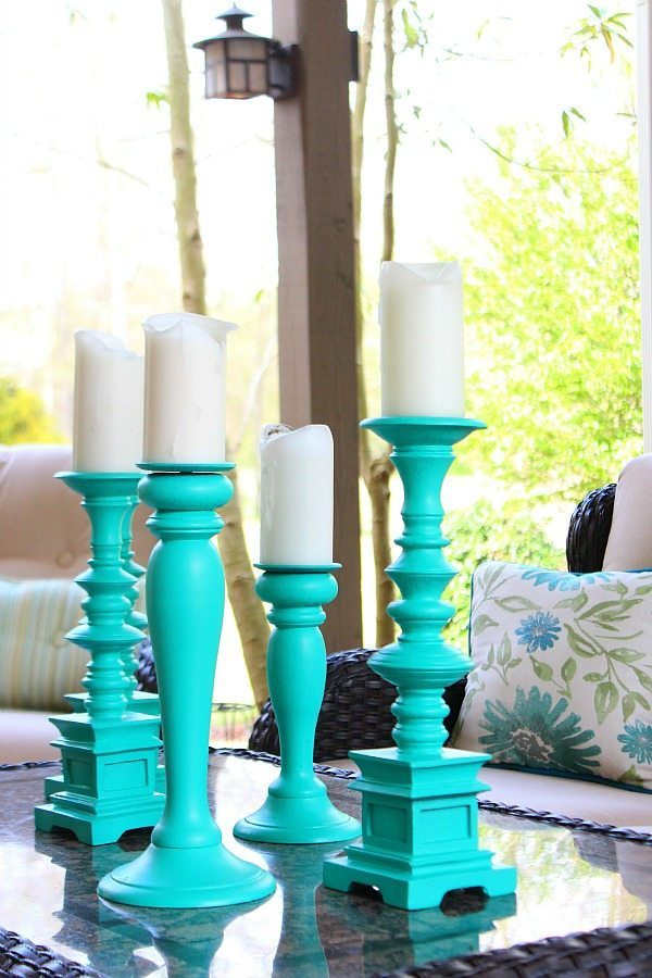 Patio refreshes with tall aqua candlesticks