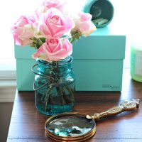 Tiffany blue box, magnifying glass and pink rose. Just a few of my favorite things.