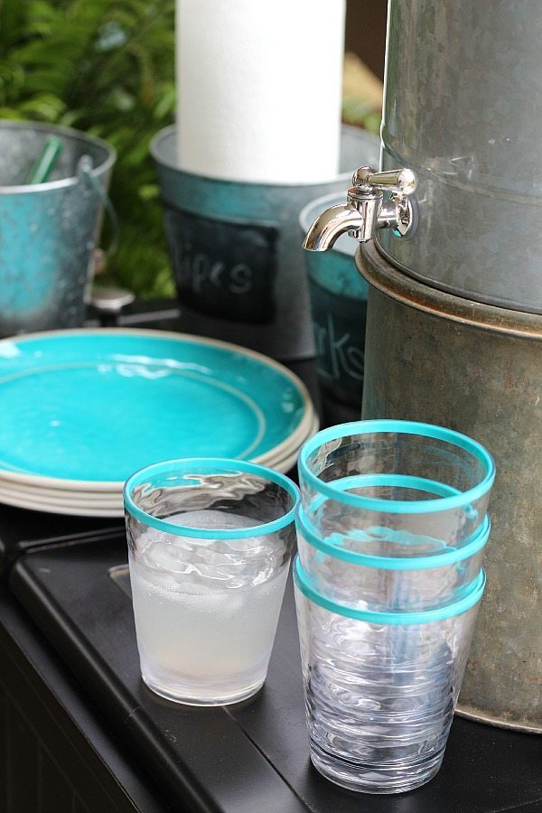 Serving station with aqua and galvanized serving pieces