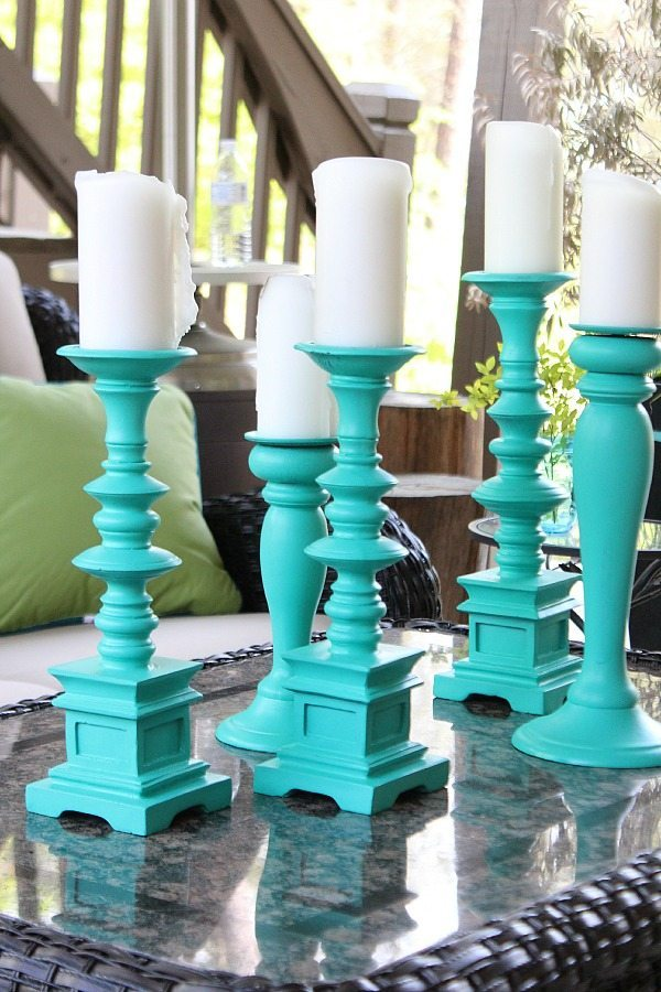 Spray paint large candle holders for a beautiful aqua statement