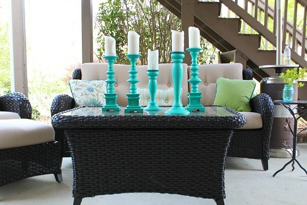 Spray paint large candle holders to create a beautiful aqua statement.