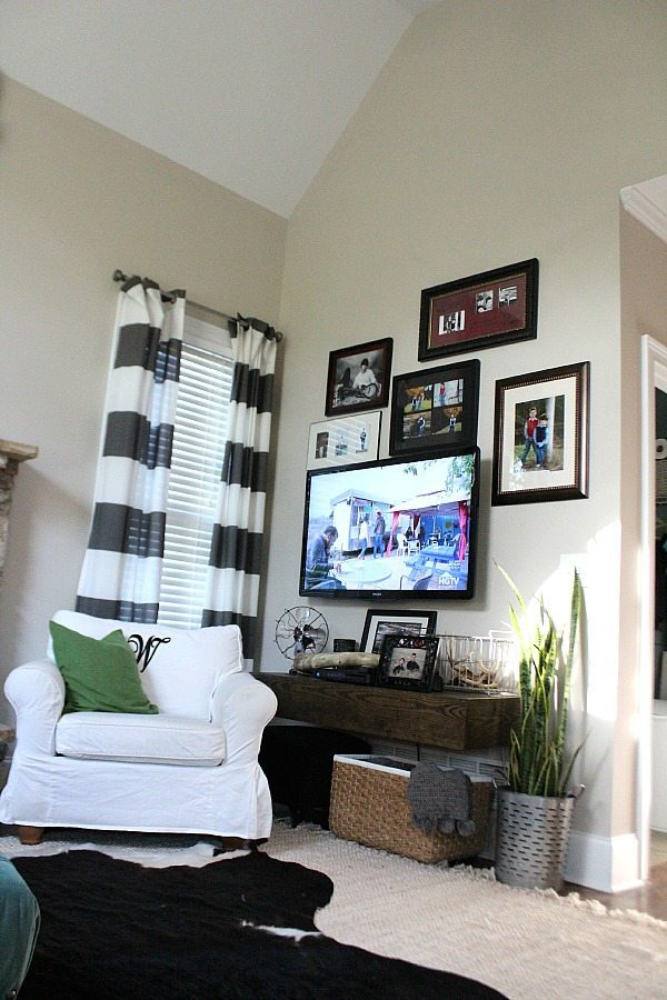 TV corner, baskets for storage and a snake plant