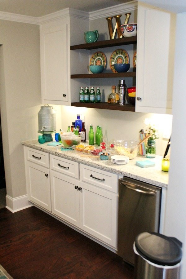 Basement makeover with serving area and ice machine Pub table made from metal and wood for the basement from BHG Walmart Kitchen area before From gutted to finished! Tips on decorating a kitchen in the basement! Light and bright for a basement.