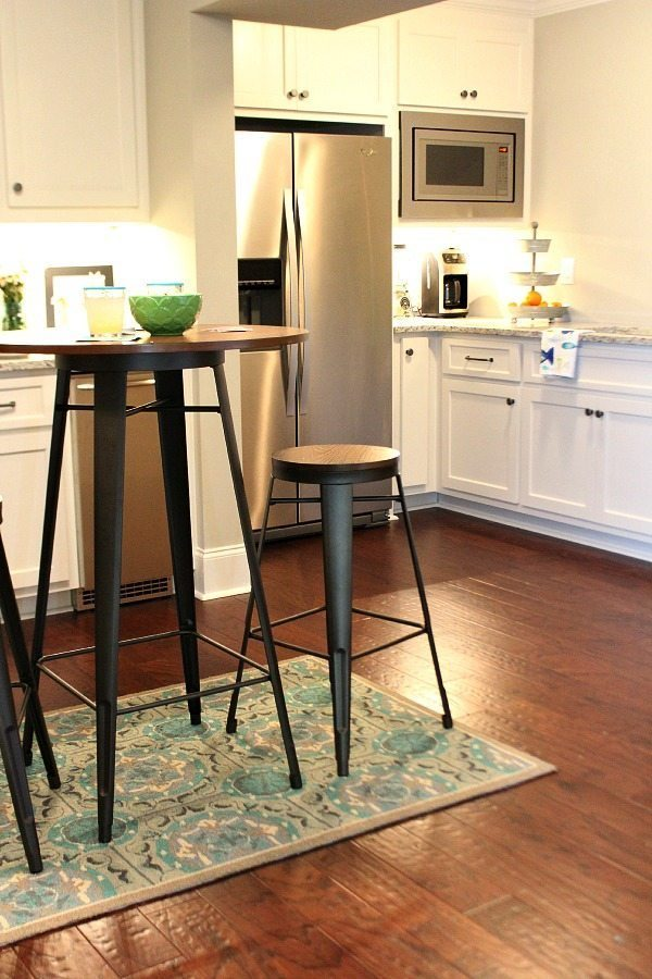 Pub table made from metal and wood for the basement from BHG Walmart Kitchen area before From gutted to finished! Tips on decorating a kitchen in the basement! Light and bright for a basement.