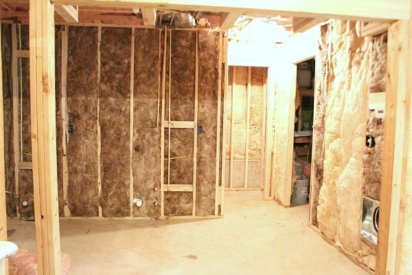 barn wood wall basement kitchen before planked wall installation at