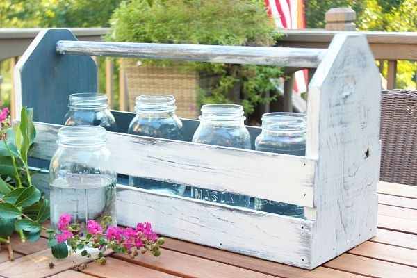 Mason jars and flowers in a wood tool box