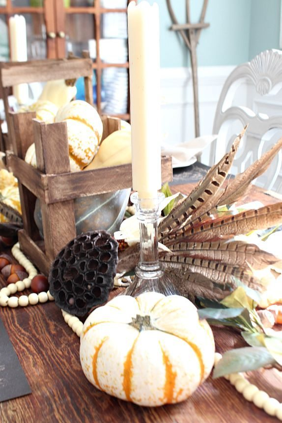 Beautiful feathers add texture to this fall tablescape refreshrestyle.com