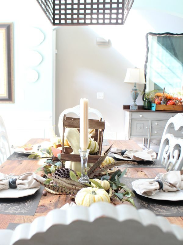 Bright and beautiful fall tablescape with feathers and neutral colors