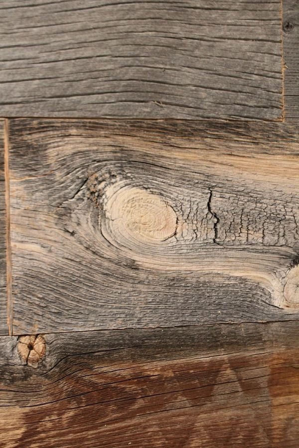 Barn Wood Wall - Close up of Stikwood Barn wood wall. Planked wall, add warmth and texture with this easy DIY wall treatment at RefreshRestyle.com