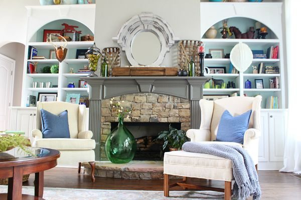 Dual bookcases surrounding a stone fireplace styling tips at refreshrestyle.com