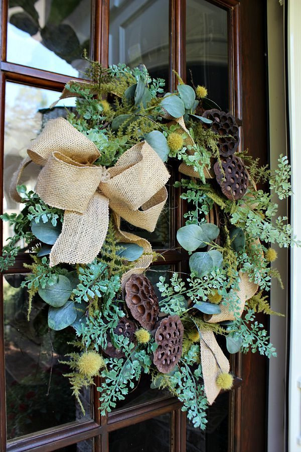 Eucalyptus, burlap, seed pods make the perfect wreath all from Daisy Mae Belle ETSY shop made for refreshrestyle.com