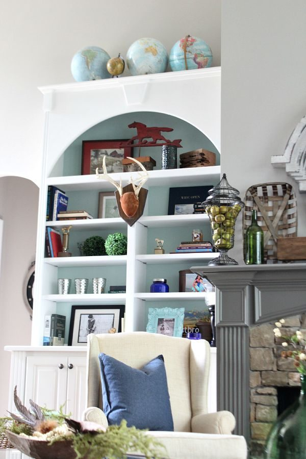 Globes, antlers, horses and books - tips for your bookcase styling at refreshrestyle.com
