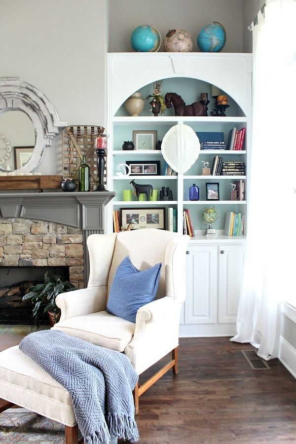 Globes, horses, books styling tips for bookcases at refreshrestyle.com