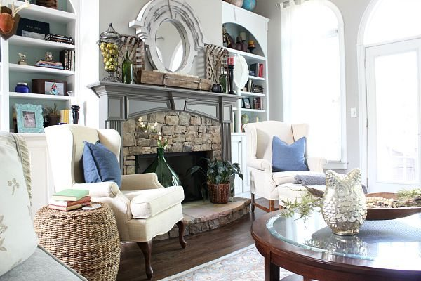 Living room with stone fireplace and dual bookcases at refreshrestyle.com
