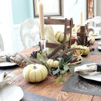Pumpkins and feathers and crates make a wonderful fall harvest table refreshrestyle.com