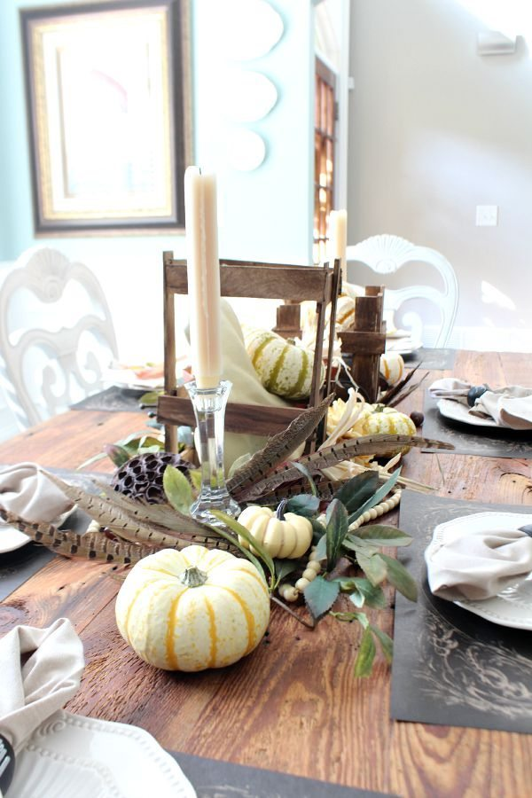 Pumpkins and feathers on the farm table refreshrestyle.com