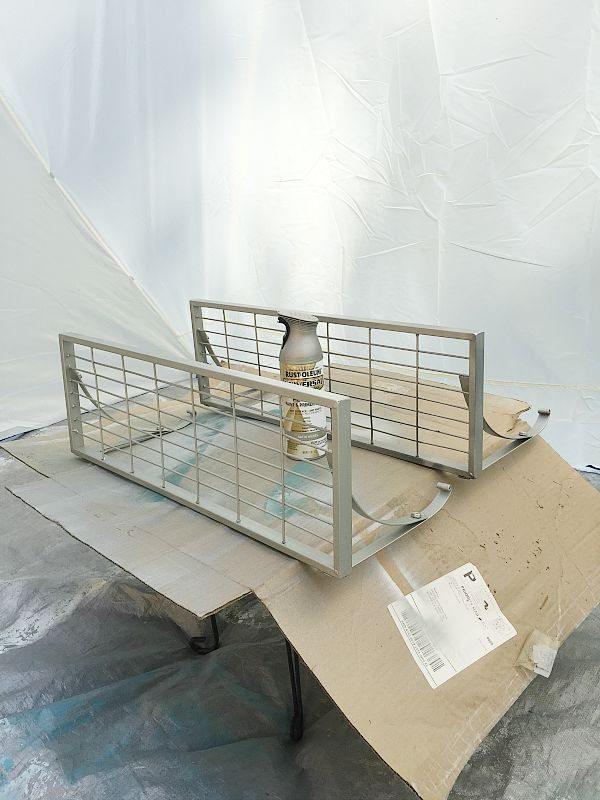 Spray painting shelves in my HomeRight spray shelter at refreshrestyle.com