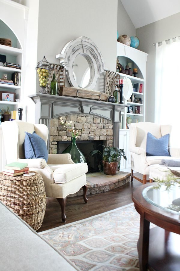 Stone fireplace flanked by bookcases at refreshrestyle.com