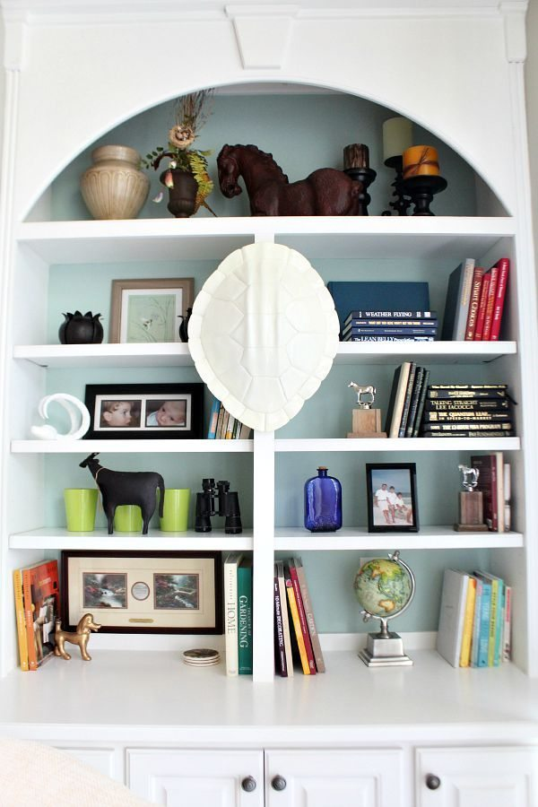 Tips for styling bookcases with items that you collect from refreshrestyle.com