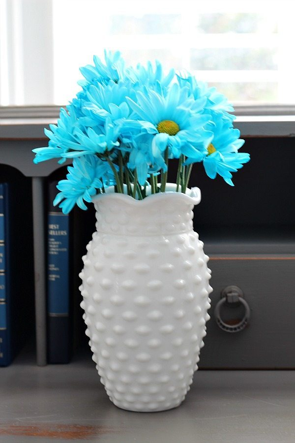 Aqua flowers in a hob knob milk glass vase at refreshrestyle.com