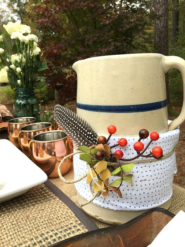 Outdoor Living with Better Homes and Gardens dish towel wrapped around the apple cider pitcher #sp #BHGLiveBetter
