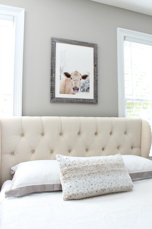 Moo Cow Minted Art above the bed in the guest room at refreshrestyle.com