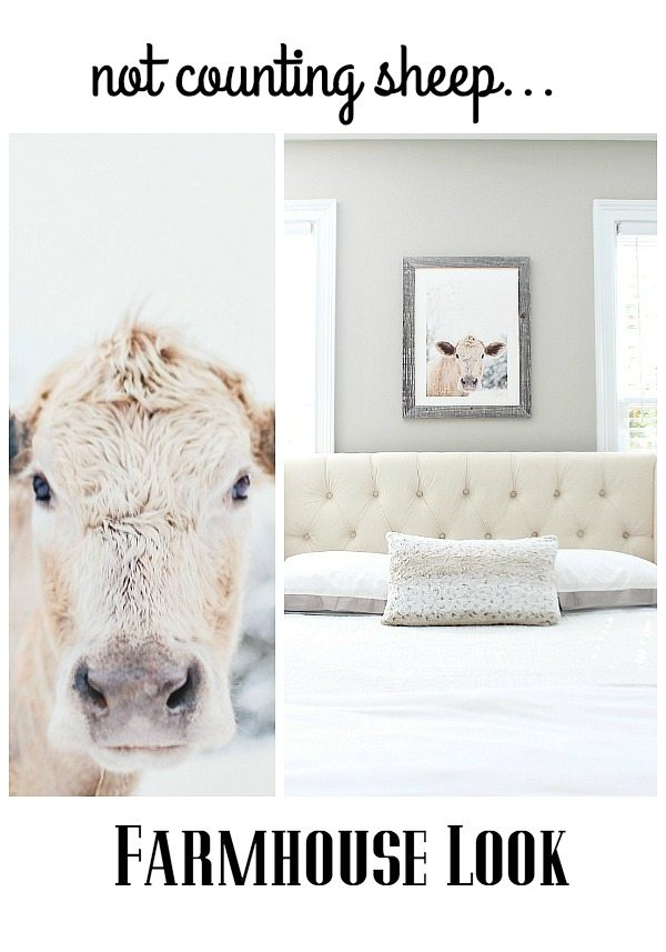 Neutral bedroom with fun moo cow art over the bed at refreshrestyle.com