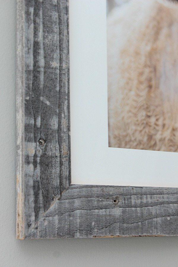 Real barnwood frame on art above guest room bed