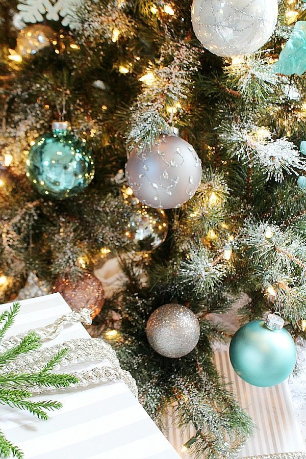 Beautiful ornaments and frosty tips on the Christmas tree