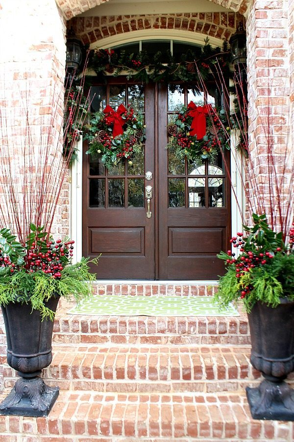 Christmas entry with twin wreaths and urns