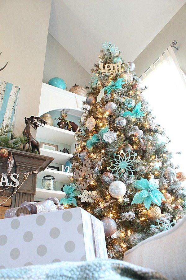 copper silver and grays really make the turquoise pop on this snowy christmas tree - Turquoise Christmas Tree Decorations
