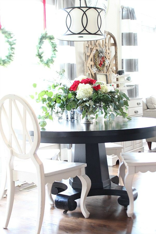 Dining Room Round black table with white chairs