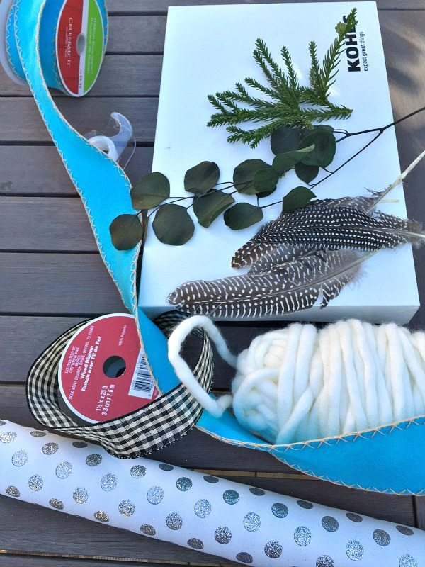 Gift wrapping idea with feathers and evergreen