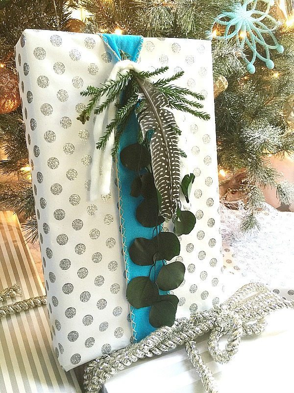 Greenery, blue ribbon for a natural Christmas gift wrapping idea