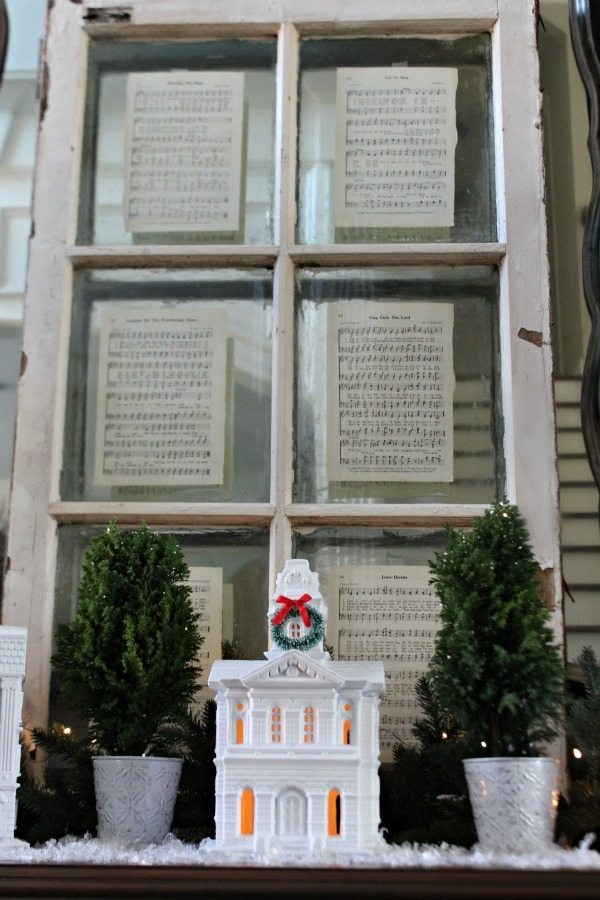 Old window with pages from an old hymnal perfect Christmas display at Refresh Restyle