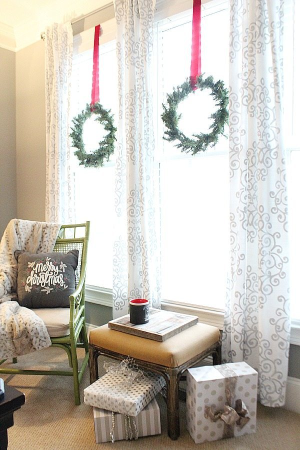 Small wreaths on the bedroom windows